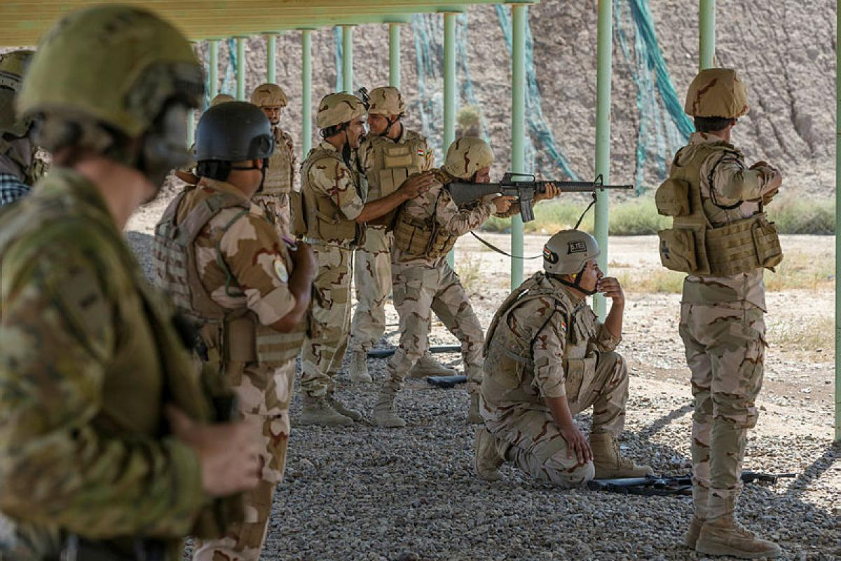 An Australian Army soldier observes as an instructor from the Baghdad Fighting School trains members of the Iraqi Army's 41st Brigade at Taji Military Complex, Iraq.