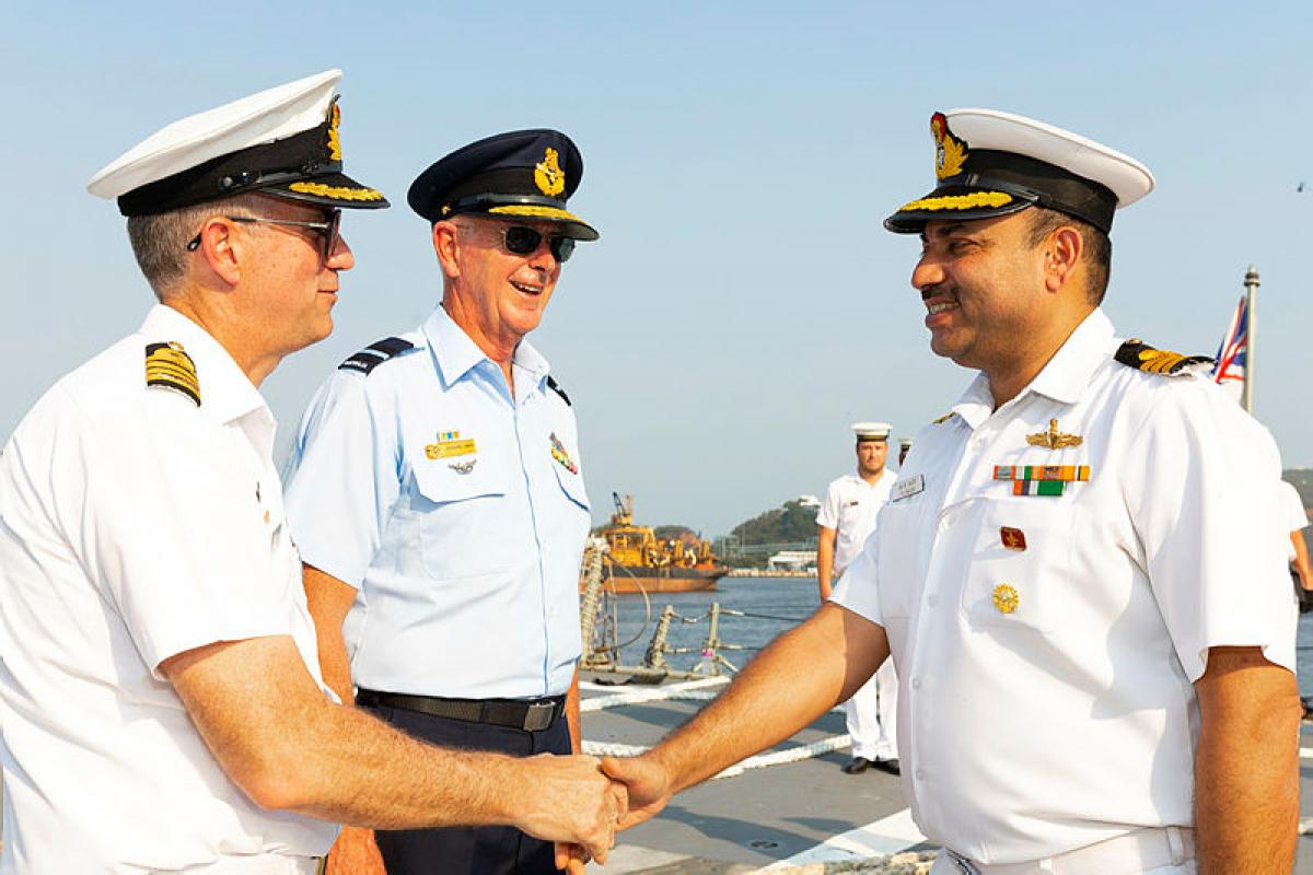 (L-R) Commander Task Group 661.1 Captain Andrew Quinn and Commander Joint Task Force 661 Air Commodore Richard Owen are greeted to Visakhapatnam Naval Base by Indian Navy Command Protocol Officer Commander Ravi Rastogi.