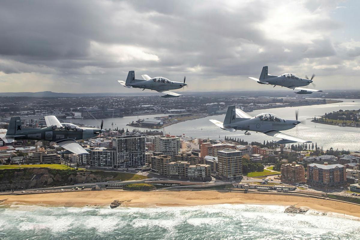 PC-9/A aircraft from No. 4 Squadron fly in tight formation near Newcastle, New South Wales. Photo: Corporal Craig Barrett