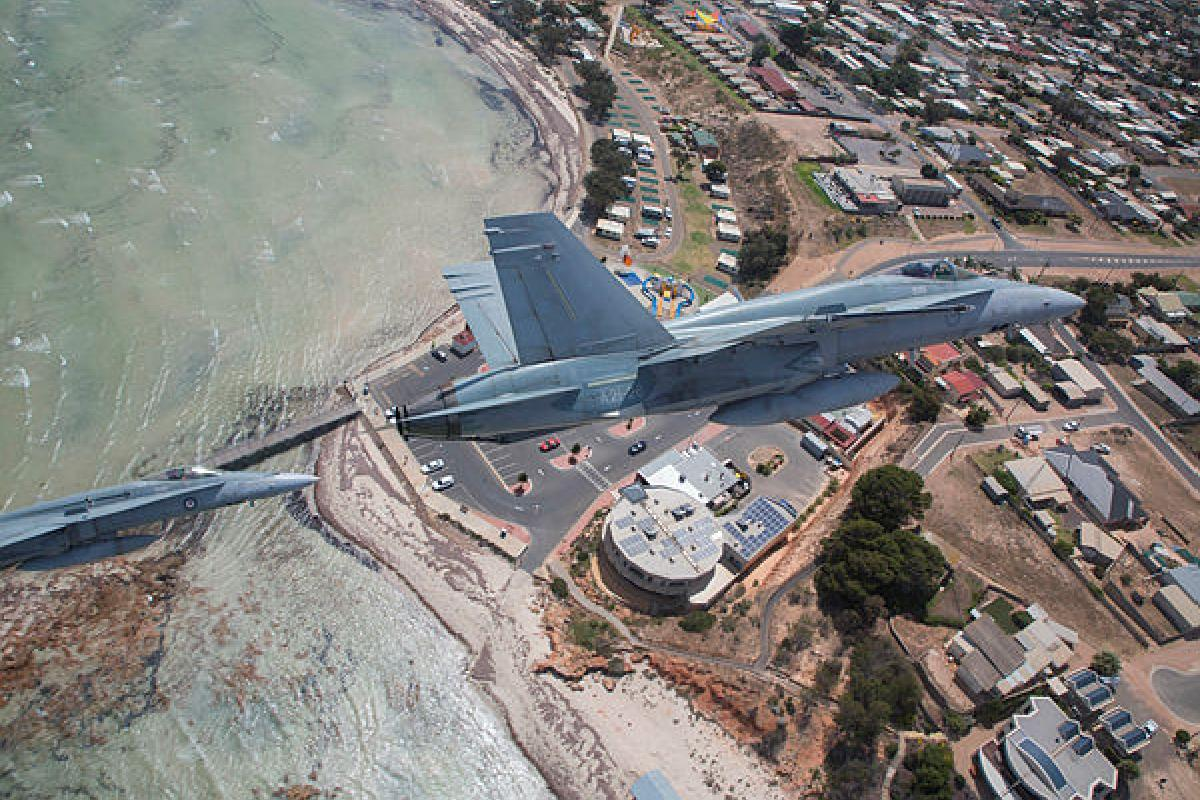 No. 75 Squadron F/A-18A Hornets fly over a South Australian coastal town in the lead-up to the RAAF Base Edinburgh Air Show. Photo: Sergeant Rob Hack