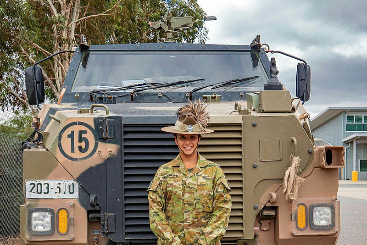 Trooper Alexis Matthews stands in front of a Bushmaster in the 1st Armoured Regiment's compound at RAAF Base Edinburgh. Photo: Private Luke Jones