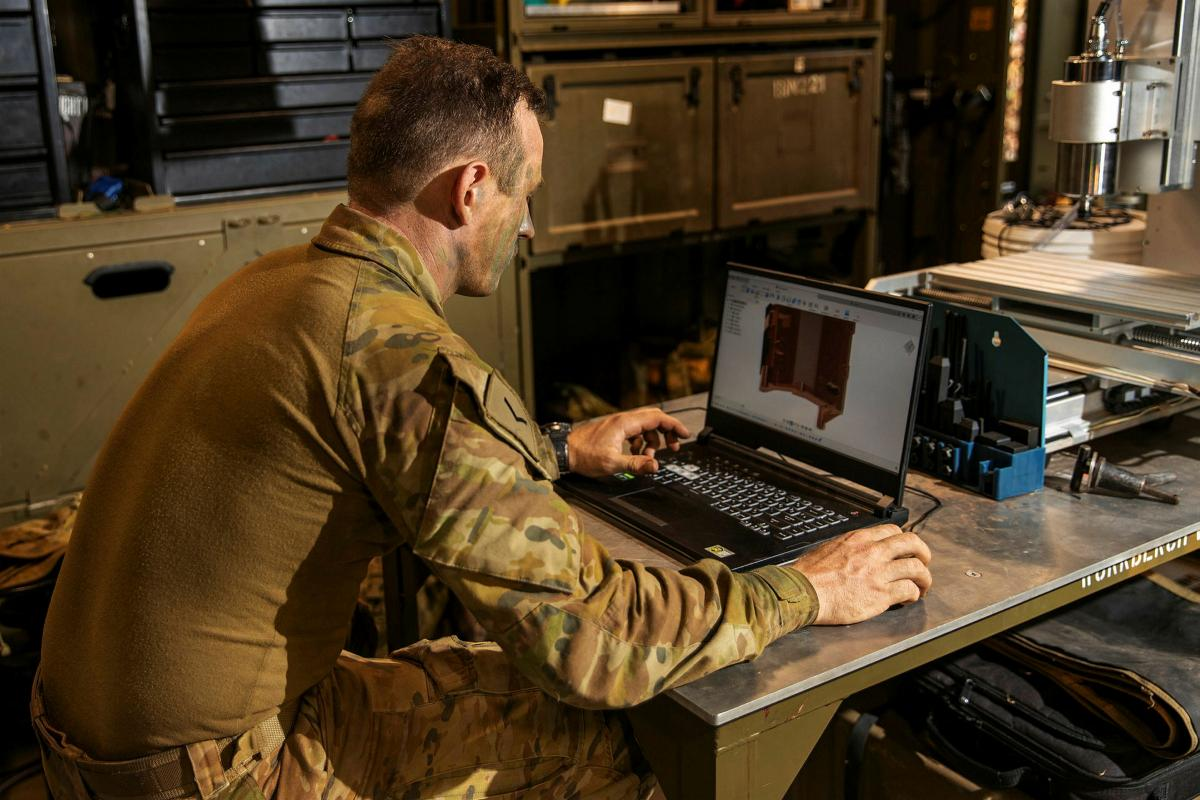 Lance Corporal Sean Barton, of 1st Combat Service Support Battalion, designs spare parts to be 3D-printed using engineering software inside a mobile workshop during Exercise Buffalo Run at Mount Bundey Training Area. Photo: Corporal Rodrigo Villablanca