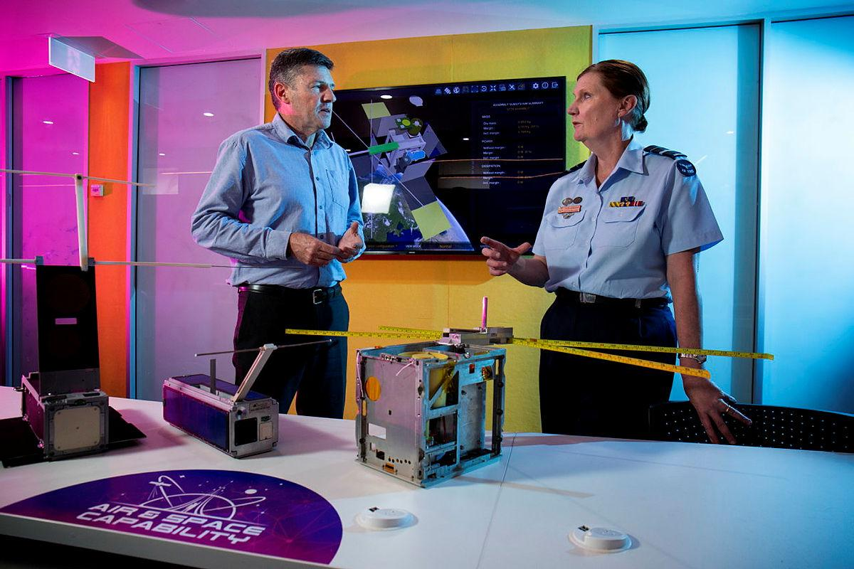 Head of Air Force Capability Air Vice Marshal Catherine Roberts speaks with Professor Russell Boyce about the M2 CubeSat at the University of New South Wales Canberra. Photo: Sergeant Oliver Carter