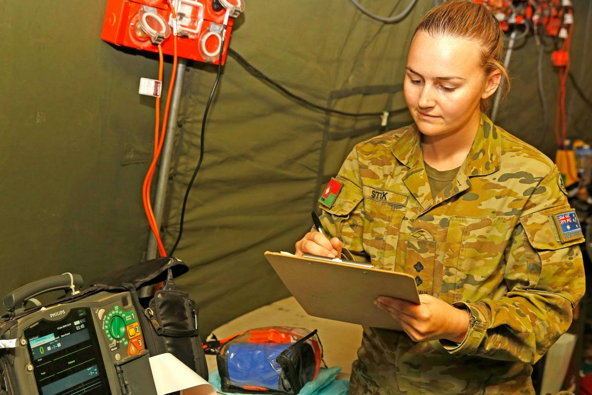Lieutenant Alison Stock, of the Brisbane-based 1st Close Health Battalion, checks equipment at a field hospital at Tumbarumba in the NSW Snowy Mountains. Photo: Sergeant Dave Morley