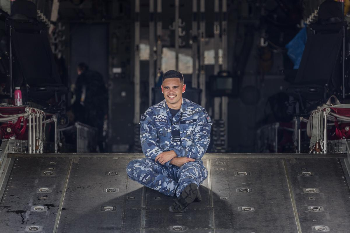 Indigenous Liaison Officer Flight Lieutenant Tjapukai Shaw on the cargo ramp of a C-130J Hercules aircraft. Photo: Sergeant Christopher Dickson