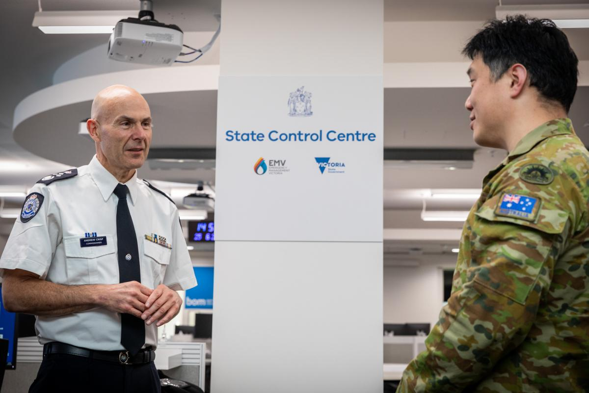 Emergency Management Commissioner Victoria Andrew Crisp speaks with Lieutenant Colonel Yi-Lee Phang at the State Control Centre in Melbourne. Photo: Leading Aircraftman John Solomon