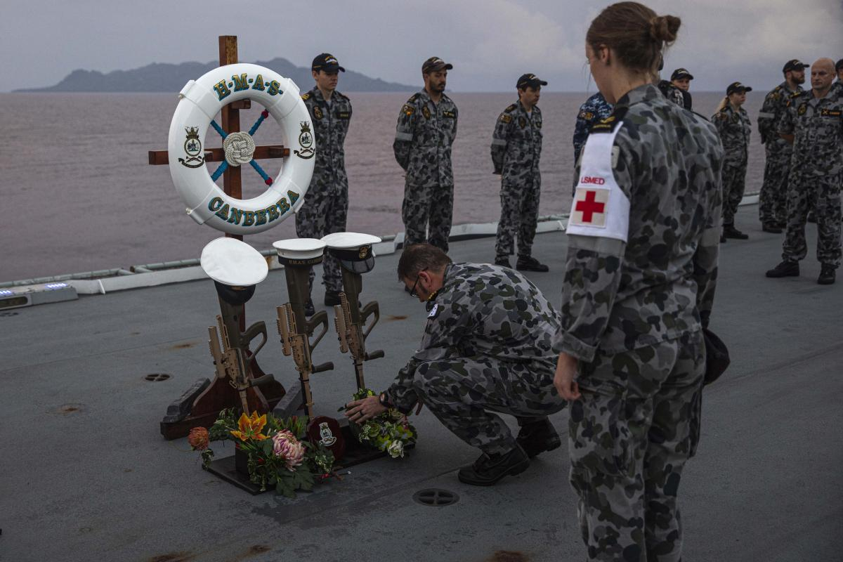 Commanding Officer HMAS Canberra Captain Terry Morrison lays a wreath to commemorate the sinking of HMAS Canberra I off Savo Island, Solomon Islands. Photo: Leading Seaman Ryan Tascas