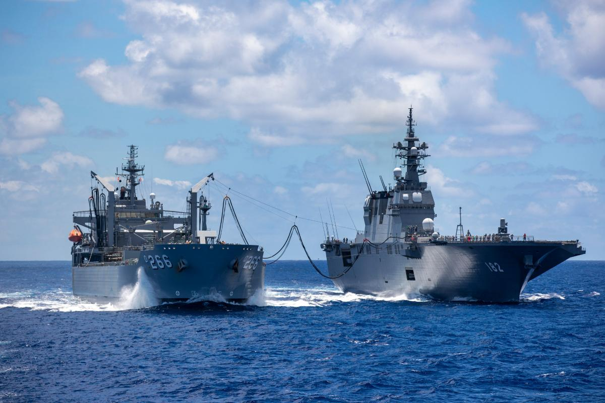 HMAS Sirius conducts a replenishment at sea with Japanese Ship Ise in the southern waters of Hawaii during Exercise RIMPAC. Photo: Leading Seaman Christopher Szumlanski