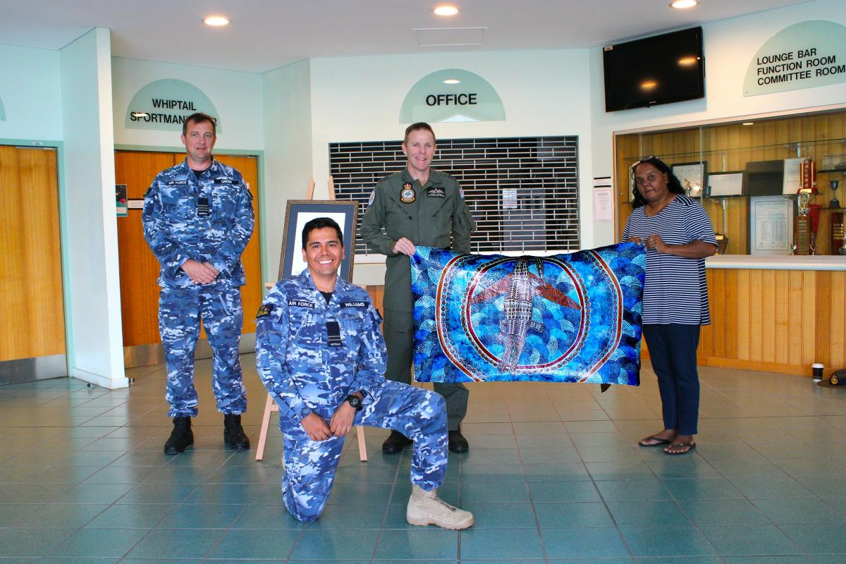 Indigenous Liaison Officer Flight Lieutenant David Williams, Wing Commander Mat Green, Squadron Leader Simon Longley and Linda Oliver at the Combat Survival Training School at RAAF Base Townsville.