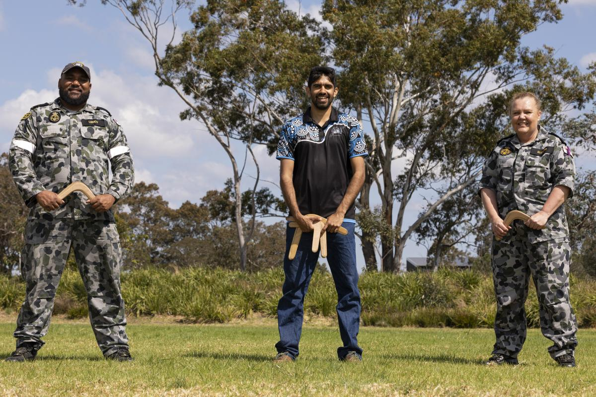 Able Seaman Boatswains Mate Jorde Lenoy, Raymond Timbery and Chief Petty Officer Medic Tina Elliot during a cultural immersion workshop at HMAS Albatross, Nowra. Photo: Chief Petty Officer Cameron Martin