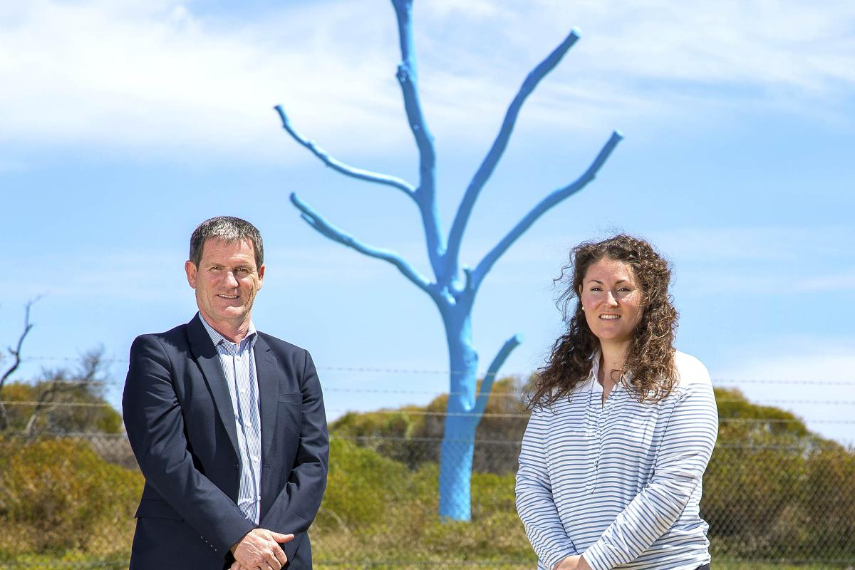 Regional Mental Health Manager ADF Centre for Mental Health Paul Blakley and Mental Health Promotions Coordinator Ali Freesmith in front of the blue tree erected at HMAS Stirling, Western Australia. Photo: Petty Officer James Whittle