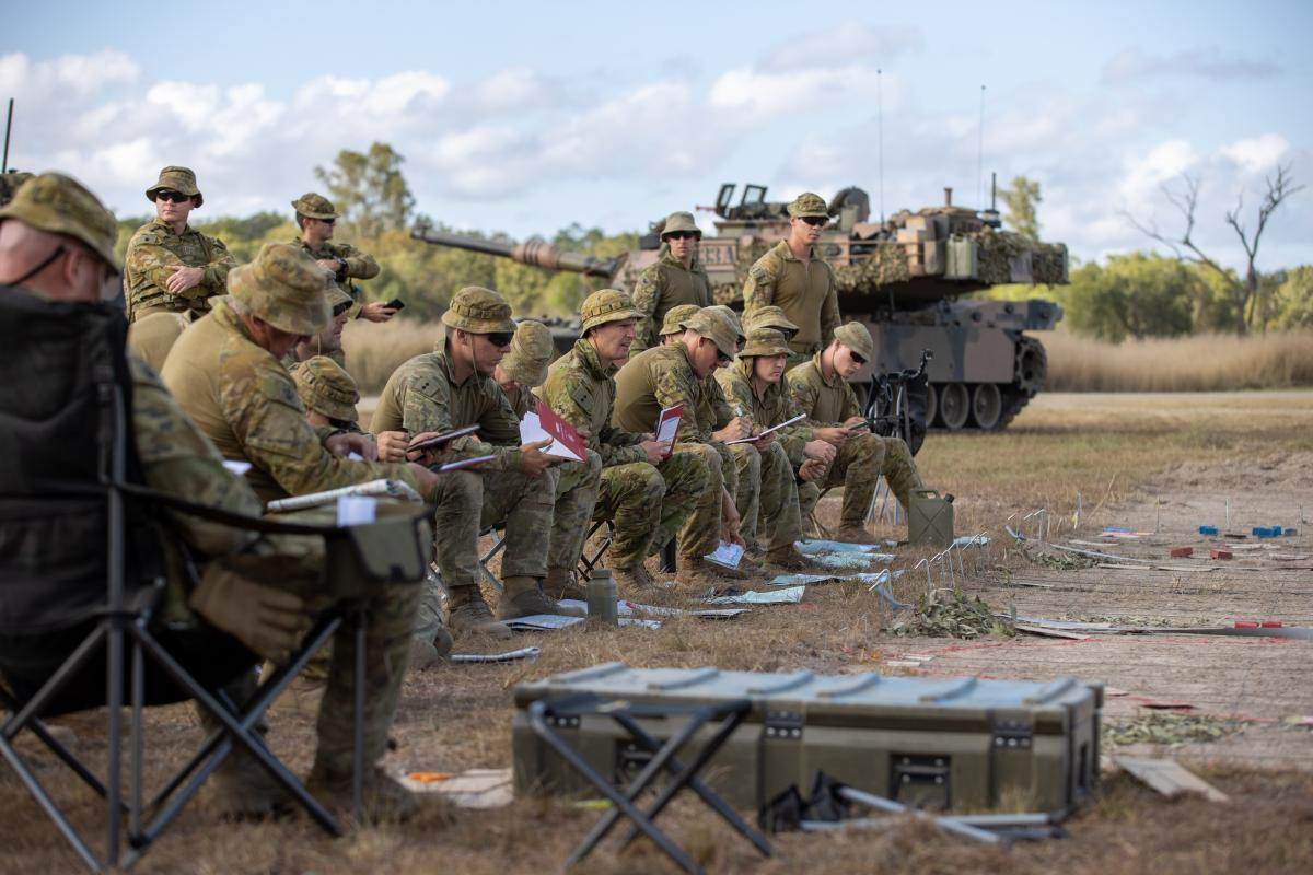 Officers of 7th Combat Brigade receive orders before stepping off on Exercise Diamond Catalyst at Shoalwater Bay Training Area, Queensland. Photo: Trooper Jonathan Goedhart