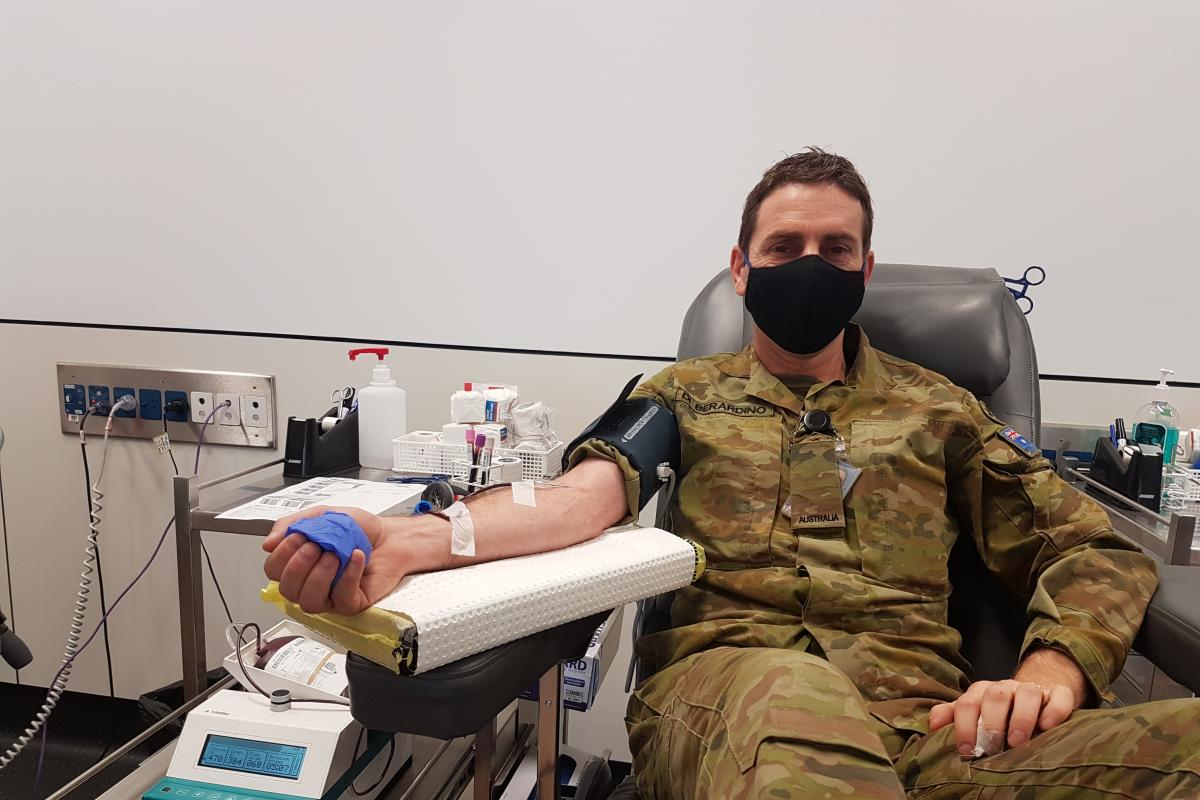 Private Anthony Di Berardino donates blood on behalf of the 4th Brigade in Victoria during the 2020 Defence Blood Challenge.