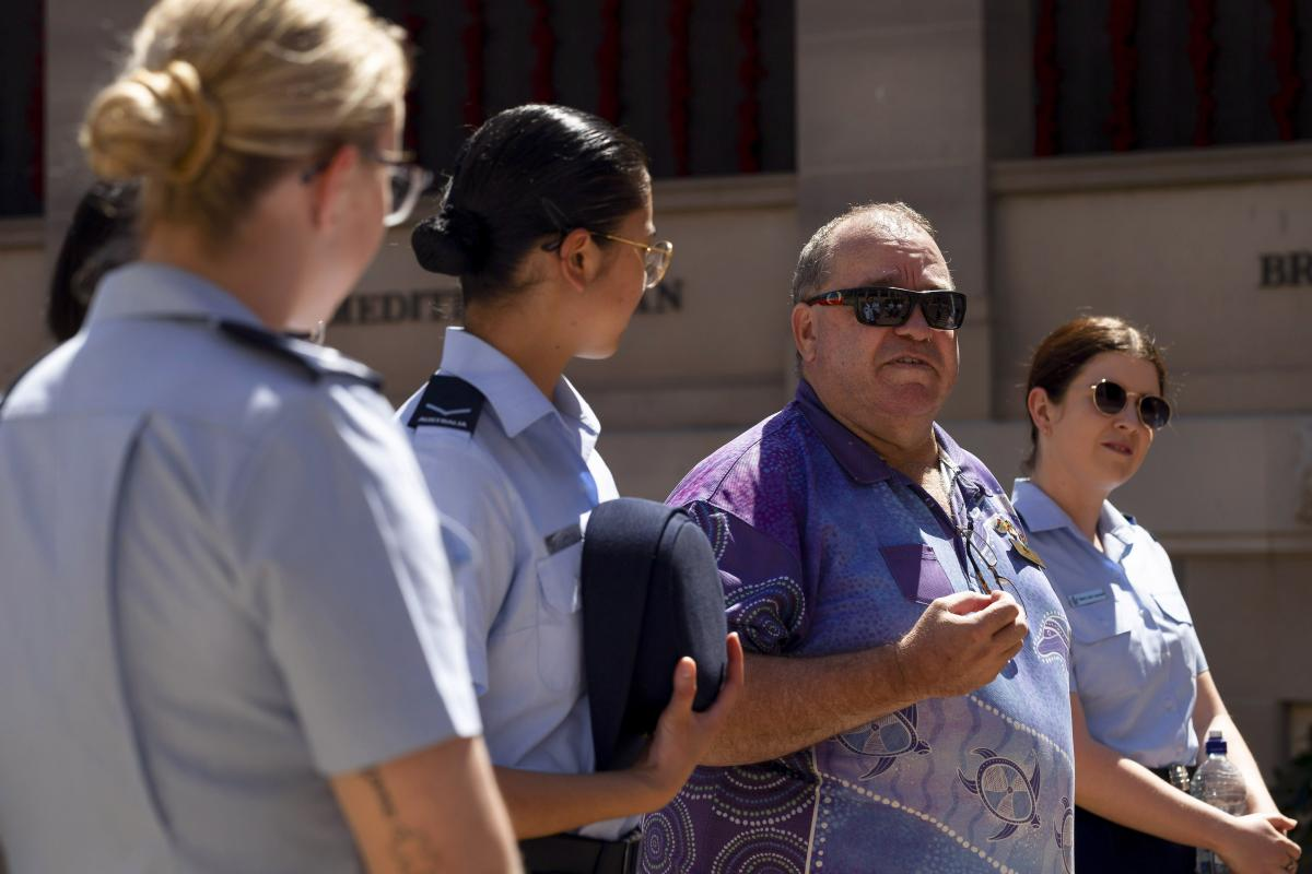 Michael Bell, centre, talks with RAAF members on a guided tour of the Australian War Memorial during NAIDOC Week. Photo: Leading Seaman Craig Walton
