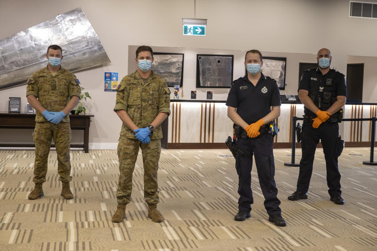 Privates Taylor Cameron, left, and Richard Jonson, of the 6th Battalion, Royal Australian Regiment, on Operation COVID-19 Assist with Queensland Police senior constables Wade Field and David Teunis. Photo: Corporal Nicole Dorrett