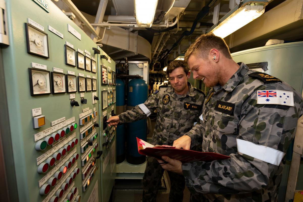 Marine technicians Able Seaman Daniel Ryan and Petty Officer Rhys Blackaby conduct routine maintenance on HMAS Ballarat during an Indian Ocean deployment. Photo: Leading Seaman Shane Cameron