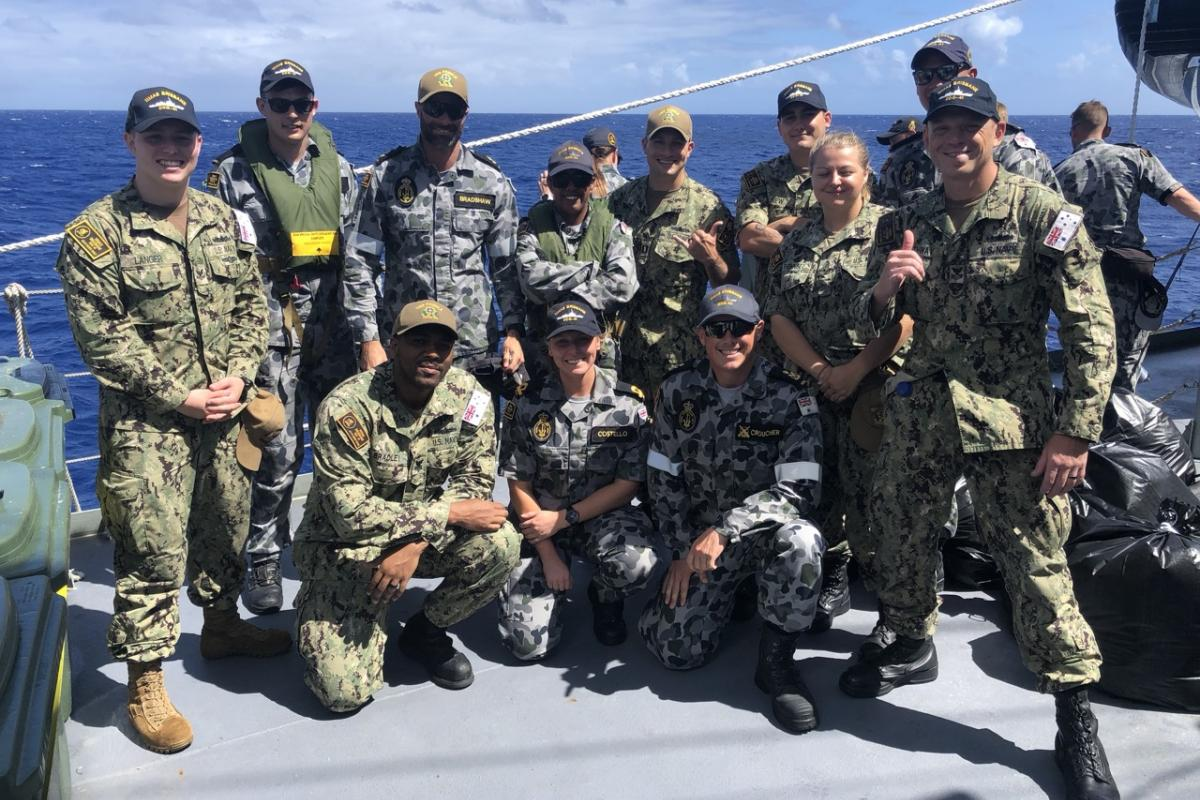 Personnel from HMAS Brisbane, USS Preble and Destroyer Squadron 31.