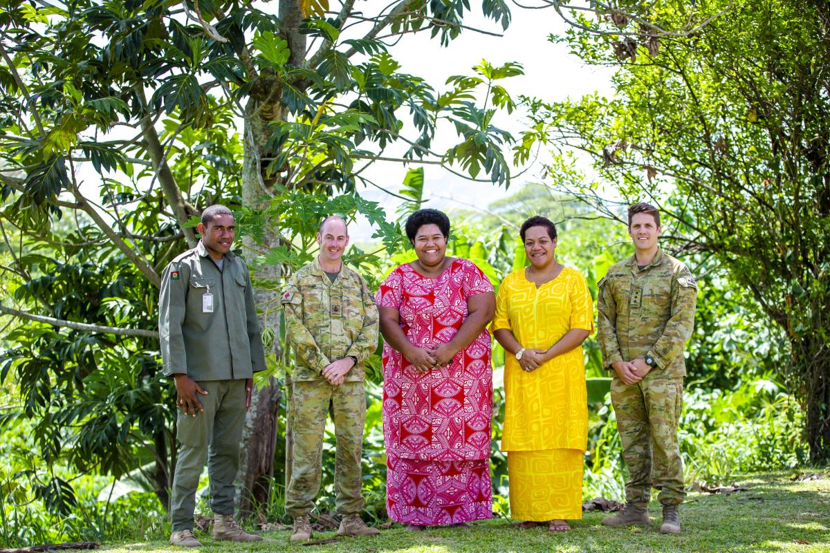 Warrant Officer Class 2 Golborn Turner, second from left, and Captain Gerard Koen, right, with a member of the Republic of Fiji Military Forces and members of the Saunaka Villiage in Nadi. Photo: Bruce Southwick