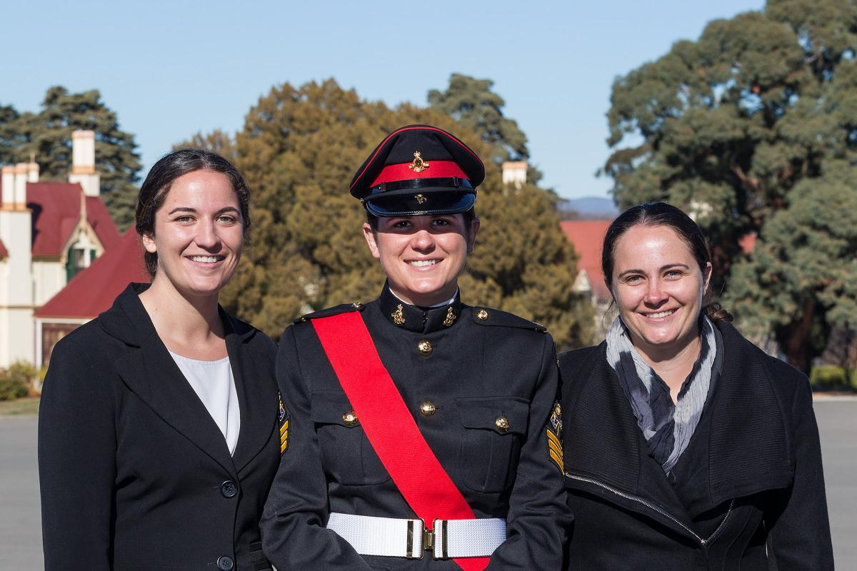 Captains Louise, left, and Joanna Farrell, right, celebrate the graduation of their sister Lieutenant Vanessa Farrell from RMC – Duntroon.