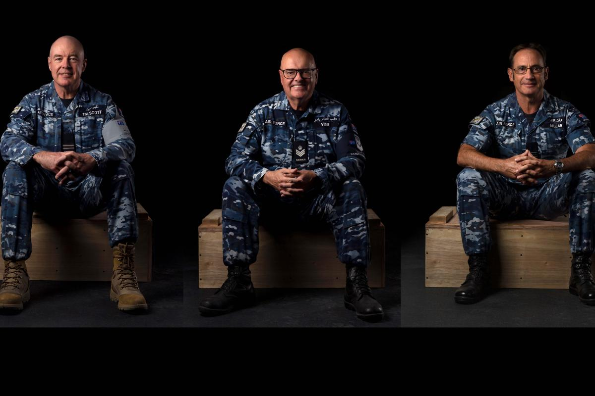 Flight Lieutenant Michael Truscott, Flight Sergeant Russell Vine and Squadron Leader John Millar at the main logistics base in the Middle East. This image is a composite of three photographs.