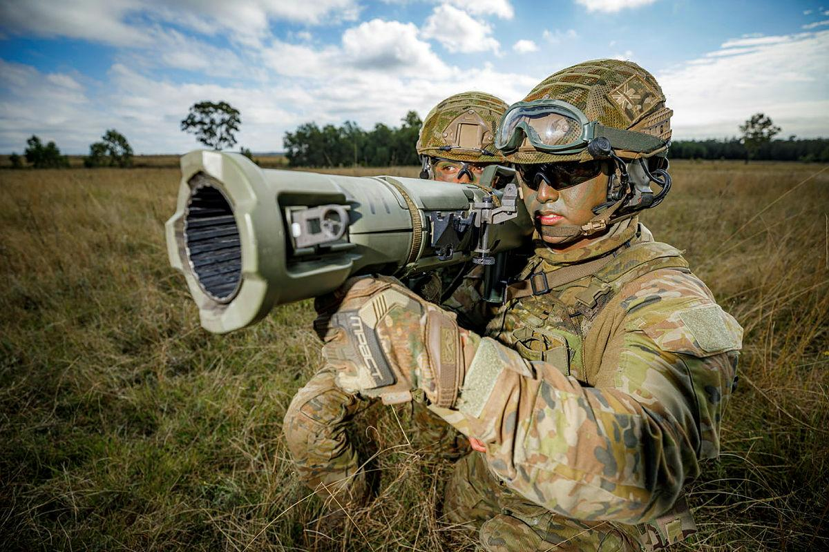 Airfield defence guards Leading Aircraftman Jarryd May, right, and Leading Aircraftwoman Tekaisha Davies from No. 1 Security Forces Squadron prepare to fire the 84mm Carl Gustav at the Singleton Military Training Area. Photo: Corporal Craig Barrett