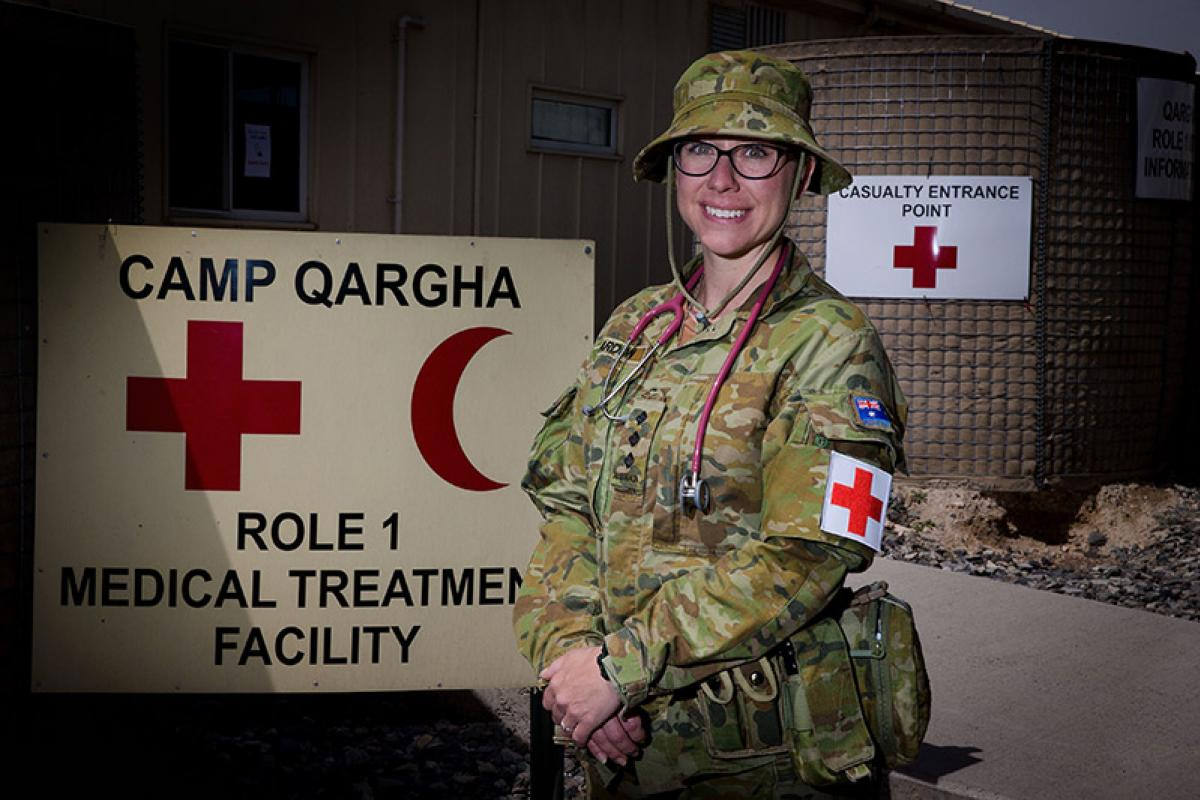 Nursing Officer, Captain Alison Reardon, of Task Group Afghanistan, prepares for her shift in the UK-led Role 1 Medical Treatment Facility at Camp Qargha while deployed on Operation Highroad.