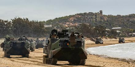 Amphibious assault vehicles drive down King's Beach, near Bowen, Queensland, during Exercise Talisman Sabre 2019.  Photo: Sgt. 1st Class Whitney C. Houston (US Army)
