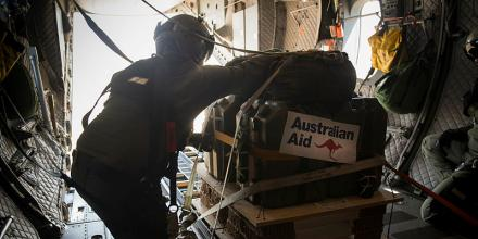 A RAAF C-27J Spartan crew member prepares to drop Australian Aid supplies to Mount Bundey Training Area during Exercise Crocodile Response. Photo: Staff Sergeant Jordan Gilbert (US)