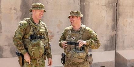 Royal Australian Air Force officer, Squadron Leader Ben Cowan (left) and his brother, Australian Army soldier Sergeant Scott Cowan at the Taji Military Complex, Iraq. Photo: Corporal Tamara Cummings