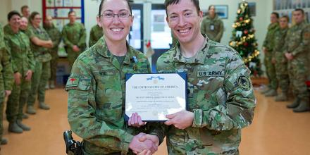 Leading Seaman Medic Tahnee White receives the American Joint Service Achievement Medal, awarded to her by the Command Surgeon, US Army Lieutenant Colonel Devin McFadden, at a ceremony in the Role 2 Hospital in Kabul, while she was deployed on Operation H