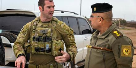 Australian Army officer Major McLeod Wood (left), who is deployed as the Officer Commanding Training Team Victor with Task Group Taji 8, speaks with Iraqi Army officer Colonel Ahmed, Baghdad Fighting School 3rd Training Wing Commander