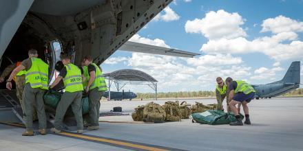 Royal Australian Air Force No. 35 Squadron and Australian Army 9th Force Support Battalion personnel load a C-27J Spartan aircraft before leaving RAAF Base Amberley for Richmond and Julia Creek in regional North Queensland.