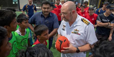 The Commanding Officer of HMAS Parramatta, Commander Troy Van Tienhoven, is greeted by the children of the 'Life is a Ball' foundation during a port visit to Chennai in India as part of Indo-Pacific Endeavour 2019.