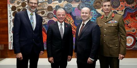 Steve Grzeskowiak, Dr Brendan Nelson, Greg Moriarty and General Angus Campbell unveil the artwork.