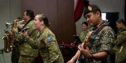 A member from the Malaysian band performs with the Australian Army band during a Dignity for School Organisation visit in Kuala Lumpur, Malaysia. Photo: Leading Seaman Kylie Jagiello