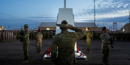 Catafalque party commander Corporal Damien Marsh, who is deployed with Task Group Taji 8, salutes during the Anzac Day dawn service at the Taji Military Complex, Iraq. Photo: Corporal Oliver Carter