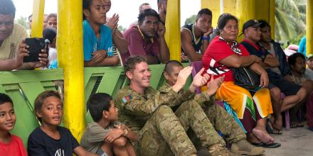 Australian Army Musician, Joshua Young cheers on his fellow band members during a live concert for the people of Funafuti at the Tuvalu airport. Photo: Leading Seaman Craig Walton