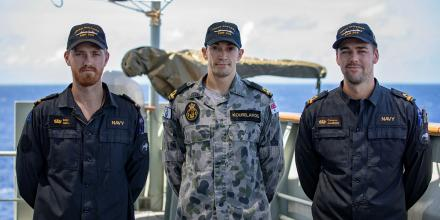 Sub Lieutenant Yuri Kourelakos (centre) and Royal New Zealand Navy Sub Lieutenants Edward Hall (left) and Cameron Jamieson (right) on HMAS Success. Photo: Leading Seaman Christopher Szumlanski