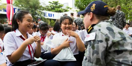 Leading Seaman Candice Beechhands out gifts to students from Thai Nguyen Secondary School in Nha Trang, Vietnam. Photo: Leading Seaman Steven Thomson