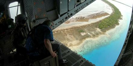 United Nations Secretary-General António Guterres views islands of Tuvalu from the ramp of a No. 35 Squadron C-27J Spartan.