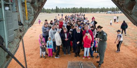 People from the Gilgandra community gather to look through a No. 37 Squadron C-130J Hercules during a community engagement visit to the area.