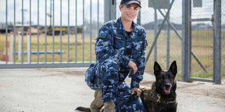 Leading Aircraftwoman Kate Williamson, of No. 1 Security Forces Squadron, and Military Working Dog Afra patrol around Rockhampton Airport during Exercise Talisman Sabre. Photo: Corporal Sebastian Beurich