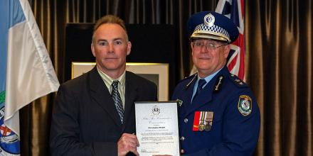 Warrant Officer Christopher Wright, left, recieves a commendation from Superintendent Dave Darcy, the Commander Northern Beaches Police Area Command, at Dee Why RSL club in New South Wales. Photo: Able Seaman Jarrod Mulvihil