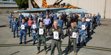 RAAF Base Williamtown personnel involved in the flying and maintenance of the F/A-18A/B Hornet gather to celebrate 400,000 flying hours. Photo: Corporal Craig Barrett