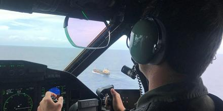 The crew of a Royal Australian Air Force C-27 J Spartan investigate a vessel spotted during an Operation Solania maritime patrol.
