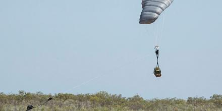 A Joint Precision Aerial Delivery System (JPADS) equipped with a 500-pound parachute descends on a drop zone at RAAF Base Curtin, Western Australia. Photo: Corporal Christopher Wager