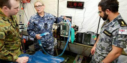 Royal Australian Air Force officer Wing Commander Kylie Hall provides critical care treatment information to Australian Army Captain Ashley St John and Royal Australian Navy medic Able Seaman Sam Ahmadyar. Photo: Sergeant Andrew Eddie