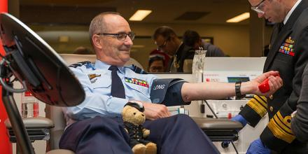The Chief of Navy, Vice Admiral Michael Noonan (right), helps the Chief of Air Force, Air Marshal Mel Hupfeld, prepare for a blood donation during the launch of the 2019 Defence Blood Challenge. Photo: Corporal Julia Whitwell
