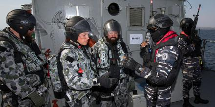 Executive Officer HMAS Maryborough, Lieutenant Iris Van Campen, left, and Able Seaman Chris Wearne, centre, with Indonesian Navy counterparts during Exercise Cassowary 2019. Photo: Leading Seaman James McDougall