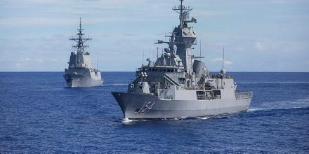 HMAS Parramatta, right, in transit on its East Asia deployment. Photo: Leading Seaman Tara Byrne